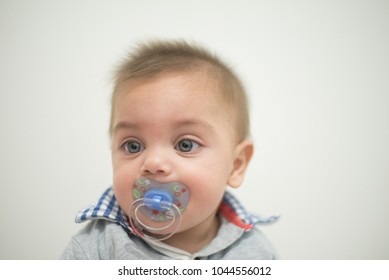 Blue-eyed baby on white background
