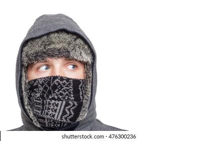 Blue-eyed boy wrapped in a hood like a ninja. Looking away.
