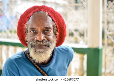 Bluefields, Nicaragua - July 15, 2015:  Elderly rasta man wears a red rasta hat which hides his long grey dreadlocks on July 15, 2015 in Bluefields, Nicaragua