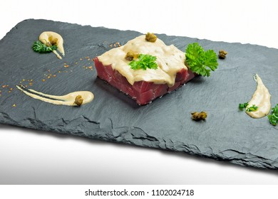 Bluefin tuna tartare with sauce on black slate