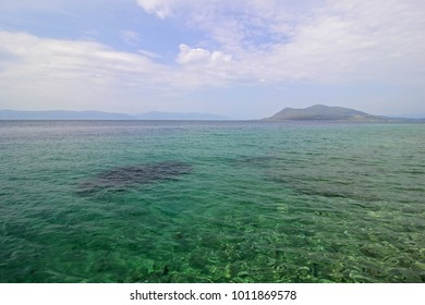 Blue-green sea water with small waves and light reflection