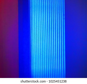 Blueish lights with dark pink abstract background photograph