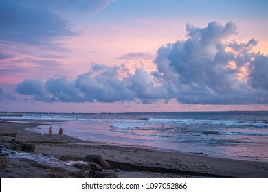 Blue-pink summer sky with clouds above the ocean at Bali
