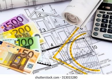 Blueprint architect money calculator symbolic photo stock photo a blueprint of an architect with a calculator and euro money symbolic photo for funding malvernweather Images