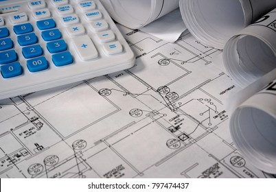 Blueprint building plan with calculator in a close up view conceptual of planning and costing of a renovation or new build