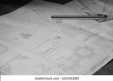 blueprint for a church building on paper with triangle ruler