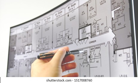 blueprint monitor of a hand with pen explain plan of a residential home apartment building on the screen in Bologna, Italy, 22 September 2019