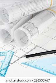 Blueprint rolls, ruler and pencil