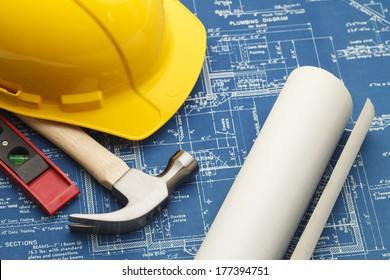 Blueprints and Construction Tools with Hard Hat.