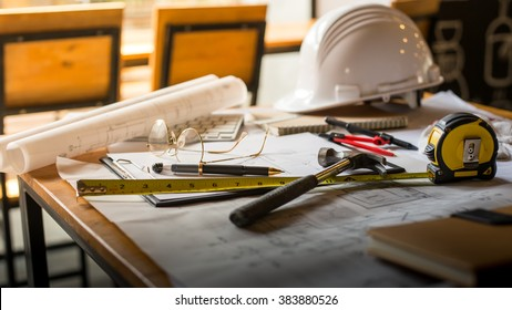 Blueprints, Hardhat, Glasses, Stickers, Construction level, Pen in architecture office retro style.