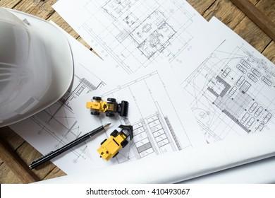 Blueprints, Hardhat or safty helmet, Pen in architecture office retro style
