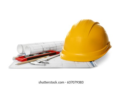 Blueprints, helmet and engineer supplies on white background