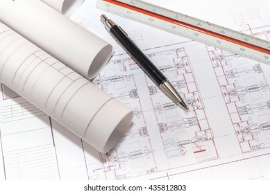 blueprints paper and rolls with pen and ruler on table detail  of architectural project, construction and renovation concept