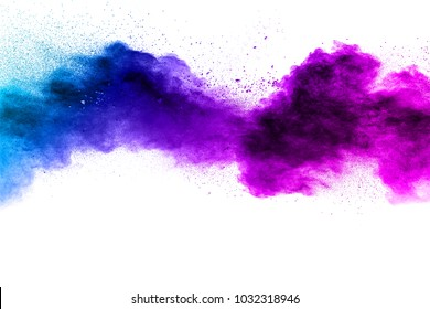 Blue-Purple color powder explosion cloud isolated on white background.Closeup of Blue-Purple dust particles splash isolated on  background.
