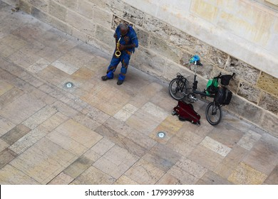 Blues busker playing sax in Seville