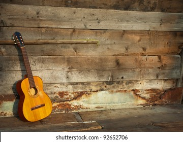 blues guitar the old wooden wall as background horizontal