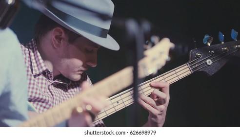 Blues in night club - guitarist plays guitar, close up