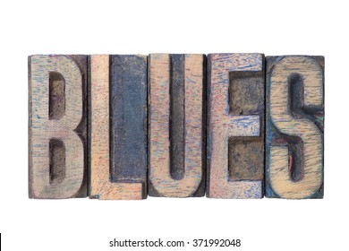blues word made from mixed wooden letterpress type isolated on white