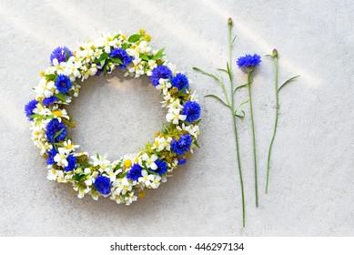Bluet floral wreath on concrete background