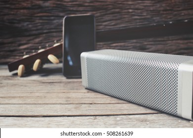 Bluetooth speaker with smart phone and guitar