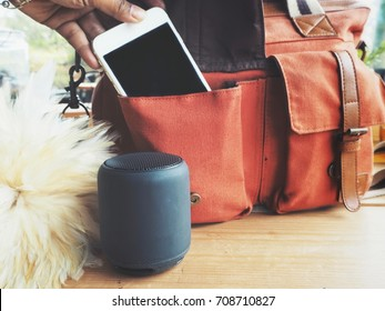 Bluetooth speaker with smart phone on bag