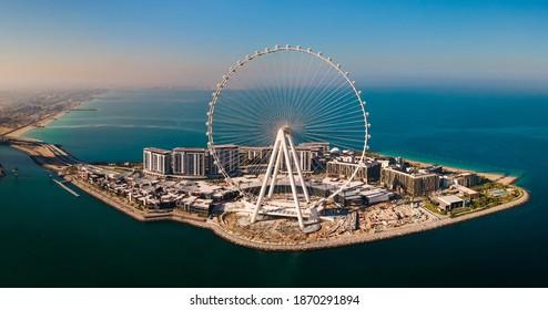 Bluewaters island and Ain Dubai ferris wheel on in Dubai, United Arab Emirates aerial view. New leisure and residential area in Dubai marina area