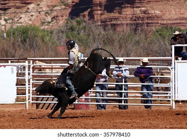 BLUFF, USA, SEPTEMBER 19, 2015: A cowboy riding a bull on a rodeo event on September 19, 2015 in Bluff, USA