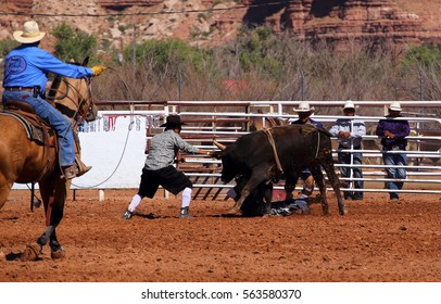 BLUFF, USA, SEPTEMBER 19, 2015: A cowboy riding a bull on a rodeo event on September 19, Bluff, USA