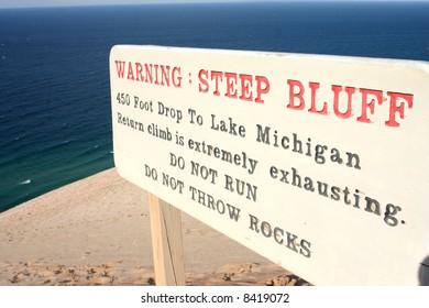 Bluff warning sign over Lake Michigan