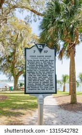 """Bluffton, SC - April 13, 2018: Sign by the The Cyrus Garvin House located within the """"Old Town"""" district tells the story of its owner and construction."""