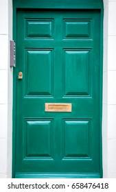 A bluish green door