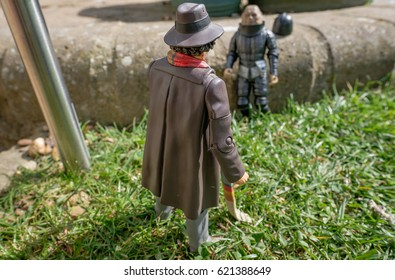 BLUNTISHAM, CAMBRIDGESHIRE, UK - CIRCA APRIL 2017: Miniature figures in the shape of a popular UK SciFi series showing in battle in a residential grade, following an invasion to the Earth.