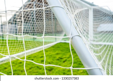 Bluntisham, Cambridgeshire, UK - Circa March 2019: Shallow focus of a newly delivered football goal located in a village park. Detail of the white netting and knots are visible.