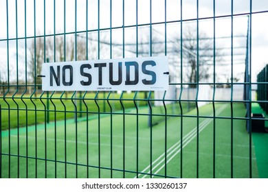Bluntisham, Cambridgeshire, UK - Circa March 2019: Shallow focus of a newly installed village cricket netting showing detail of the No Studs sign on the wire entrance. Used for cricket club practicing