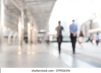Blur abstract  background of business people walking in the walkway of building office/ silhouettes motion style