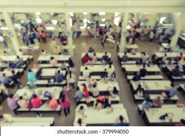 Blur abstract background of cafeteria in University or food court in shopping mall. Vintage style color effect.