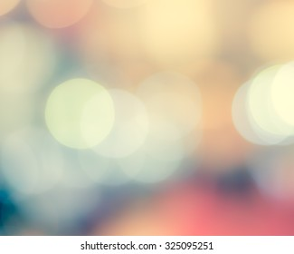 Blur abstract background city night light party bokeh in vintage style in warm pink yellow blue color