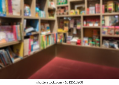 Blur abstract background of corner book on bookshelves in bookstore. Blurry view library as background
