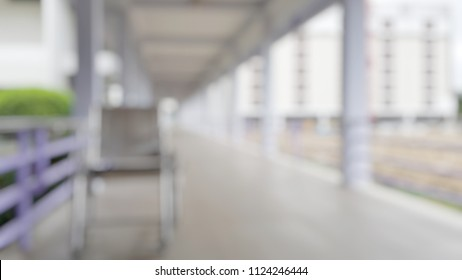 Blur abstract background of corridor in clean hospital with patient wheelchair Blurry  wheel chair for World Disability Day.
