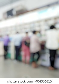 Blur abstract background of drugstore with customers consulting with Pharmacist. Blurry view of customer waiting to pay at phamacy