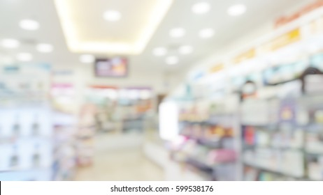 Blur abstract background drugstore with customers. Blurry view of drug store and pharmacist. Blurred clean pharmacy with medicine on shelves. Defocus white drugstore.