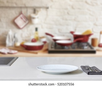 Blur abstract background modern tiles wall, white table with modern kitchen accessories, interior design