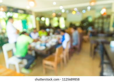 Blur Abstract Background of People or Asian men Business Meeting in Restaurant or Coffee Shop as Modern Business Lifestyle Brainstorming and Cooperative