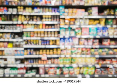 Blur abstract background of people shopping in super market ,products on shelves ,Supermarket with bokeh,customer defocus ,vintage color