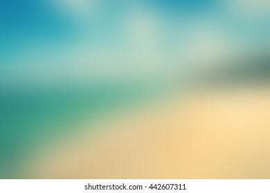 Blur abstract background of sea sand sun beach. Blurry idea ocean  blue sky  clear white wave soft light bokeh flare.Defocus relax sunny cloudy paradise heaven concept.