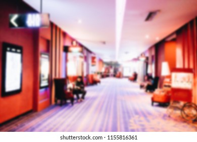 Blur abstract cinema lounge interior background, cinema hall in shopping mall unfocused bokeh background