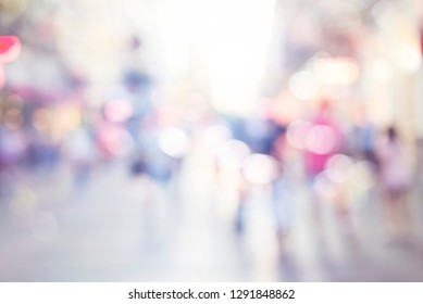 blur abstract people background, unrecognizable silhouettes of people walking on a street