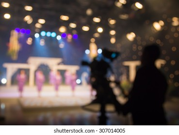 Blur actress or singer in television studio station with camera