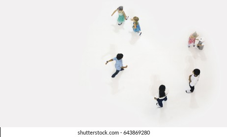 blur adult and children play and run on the white playground at the top aerial view