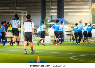 Blur the artificial turf with a white stripe and coaching soccer